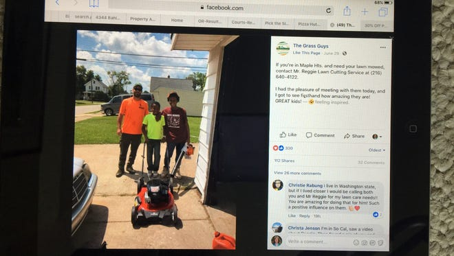Reggie Fields, 12, of Maple Heights, Ohio, gets a visit from some lawn-care professionals in Twinsburg, Ohio, after a neighbor called Maple Heights police on him for mistakenly cutting a strip of their grass. The Lawn Guys gave him a new blower and showed him how to use a push mower that another person donated.