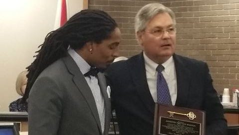 Mayor Randy Henderson presents Tre Boston with a key to the city Monday