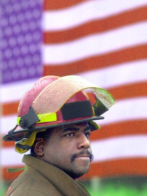 Cincinnati firefighter Daryl Gordon stands at Fifth Street and Central Avenue downtown Sept. 19, 2001.