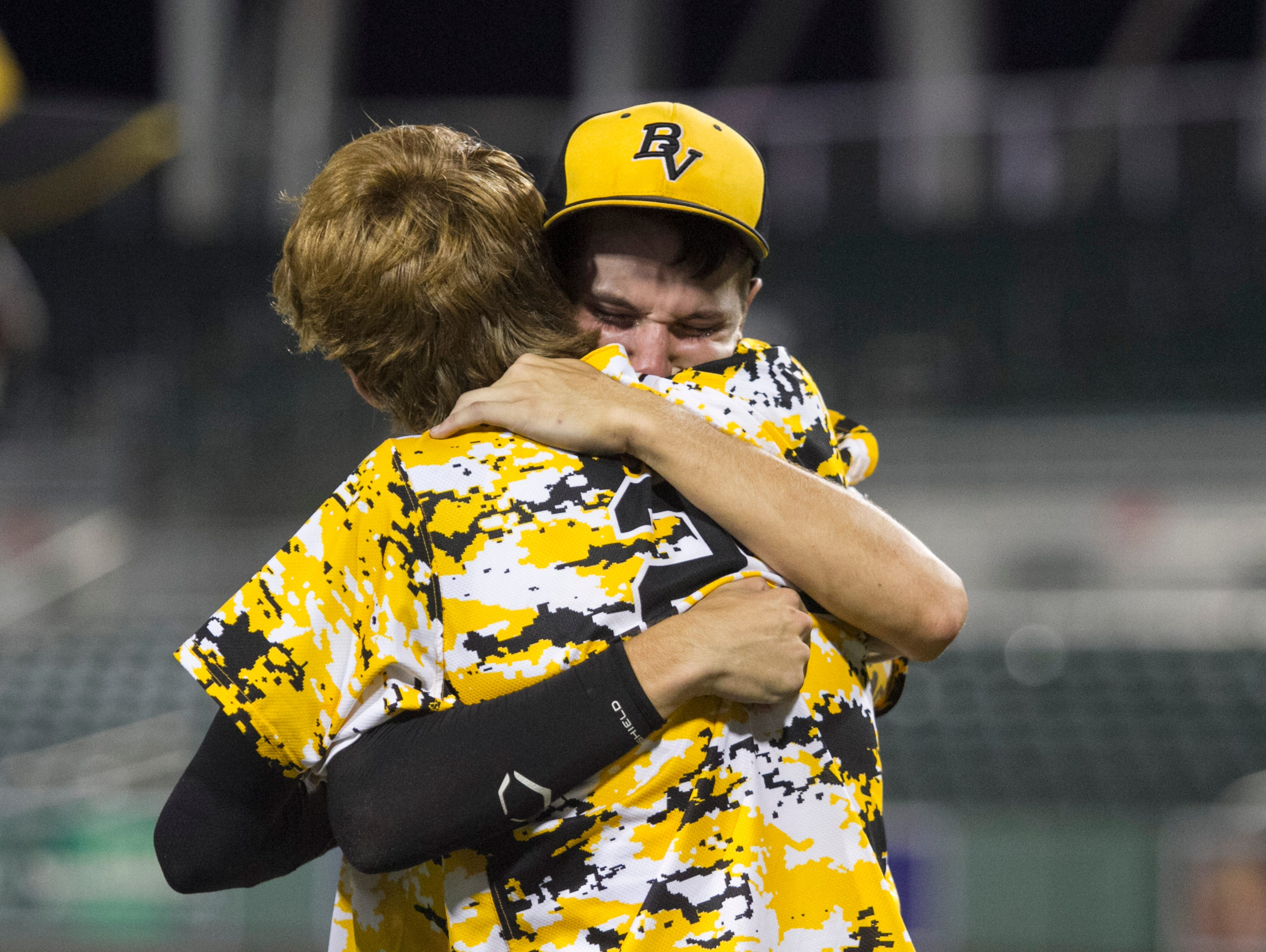 Bishop Verot's Thaddeus Ward and Trevor Cramer console each other after losing to Jacksonville Trinity Christian in the Class 4A State Baseball final on Tuesday, May 19, 2015, at JetBlue Park in south Fort Myers.