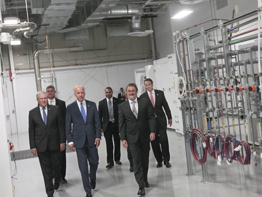 Vice President Joe Biden, center, and other officials