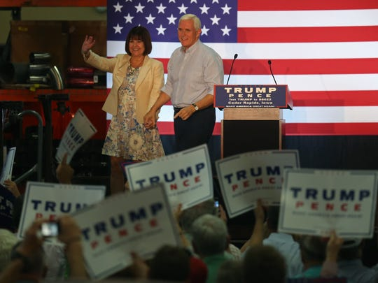 Republican Vice Presidential candidate Mike Pence and his wife Karen Pence take the stage for a town hall at Modern Companies Inc. on Monday, Aug. 22, 2016, in Cedar Rapids.
