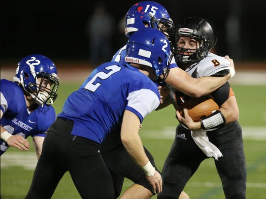 Blanchet's Jack Coen (No. 2) and Denver Bogat try to take down Scio's Dru Cook in a PacWest Conference game on Friday, Oct. 14, 2016, at McCulloch Stadium in Salem.