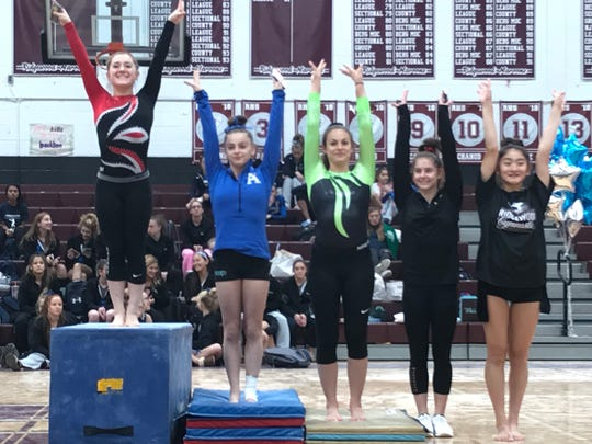 The top five finishers in the North 1 sectional gymnastics floor exercises (from left): champion Sara Buchner of Westwood, runner-up Faith Furletti of Holy Angels and, tied for third, Ramapo's Jill LoPresti, Mount Olive's Brittany Wilder and Ridgewood's Megumi Tamura.