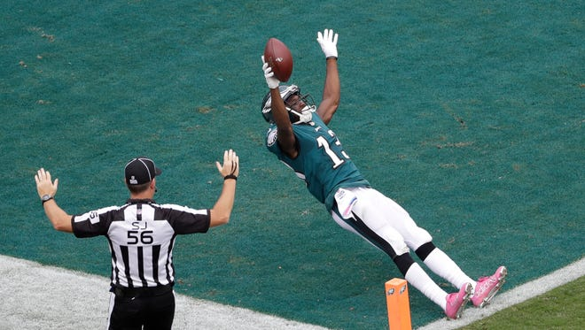 Philadelphia Eagles' Nelson Agholor celebrates as he crosses the goal line to score a touchdown during the second half of an NFL football game against the Arizona Cardinals, Sunday, Oct. 8, 2017, in Philadelphia.