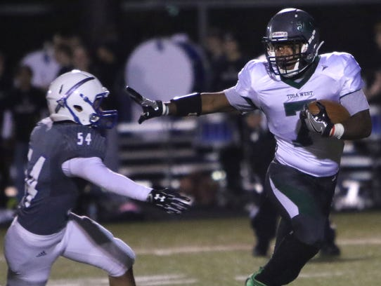 Wauwatosa West's Jacob Braxton (7) attempts to run