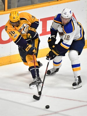 Predators defenseman P.K. Subban (76) moves the puck while being defended by Blues center Jori Lehtera (12) during the third period of Game 3 on Sunday, April 30, 2017.
