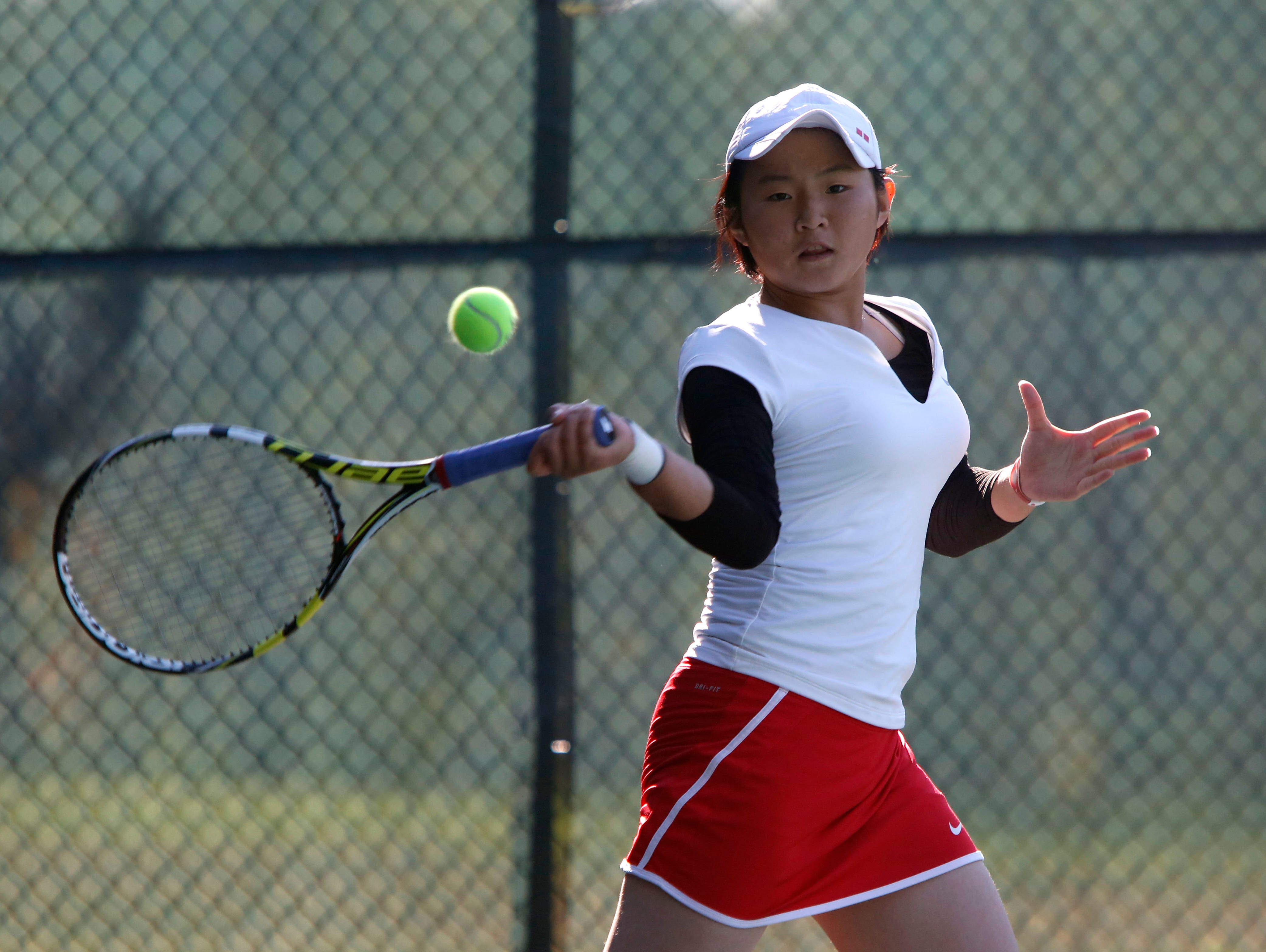 Mayu Tezuka of Keio returns the ball to Pleasantville's Olivia Ashton in the Conference III tennis tournament Thursday at Edgemont High School in Scarsdale.