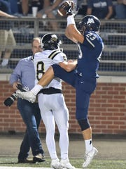 Jackson Academy's Walker Benner (23) makes a catch against Oak Forest during game action Friday, November 3rd, 2017 in Jackson, MS.(Bob Smith-For the Clarion Ledger)