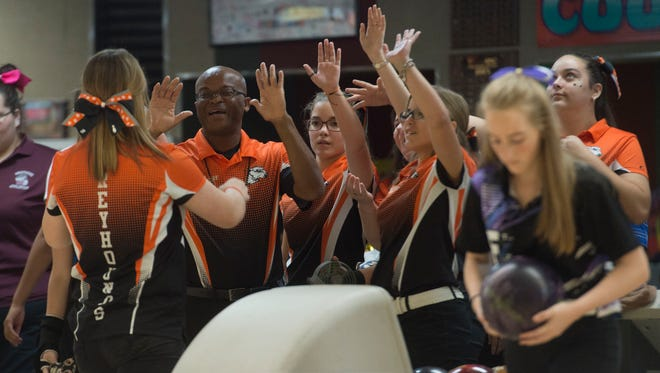 The Lincoln Park Academy girls bowling team celebrates during the the Florida High School Athletic Association District 11 bowling tournament on Monday, Oct. 23, 2017 at St. Lucie Lanes in Port St. Lucie. The team went undefeated through the regular season and were 2016's state runner-up.