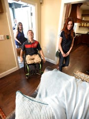 "Disabled veteran Tim Donley, and his wife Kelly, now have a suitable place to call home. With over 100 guests in attendance, the Stephen Siller Tunnel to Towers Foundation presented Cpl. Tim Donley with the keys to his ""Smart Home"" near Bethel, PA. Thursday, June 8, 2017. Donley lost both his legs and had severe damage to one arm when an IED exploded near him February 9, 2012 while on patrol in Afghanistan. Donley and his wife Kelly cross the threshold into their new home for the very first time Thursday following a ceremony and flag raising."