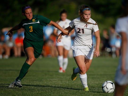 Cedar Rapids Kennedy junior Olivia Hellweg (3) tries