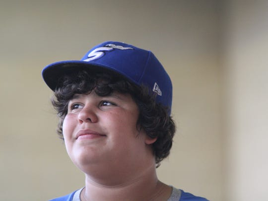 Cincinnati Steam bat boy Omar Mrabet, 12, has become an unmistakable presence in the Steam dugout over the last two seasons. Pictured here prior to a game on Tuesday, July 31, 2018.