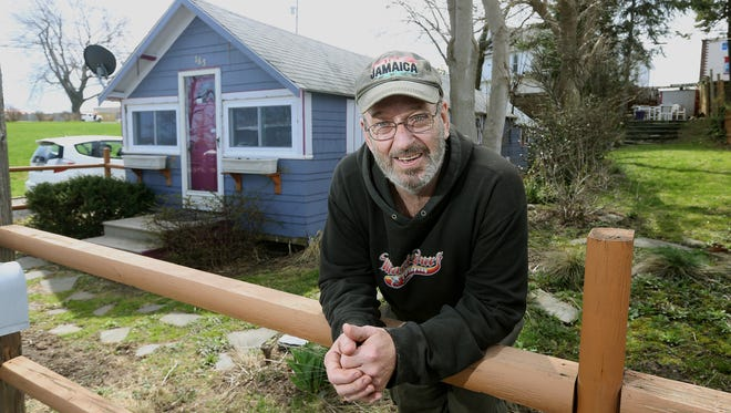 Jack Kiggens received grant money to help fix his modest cottage in Sea Breeze.