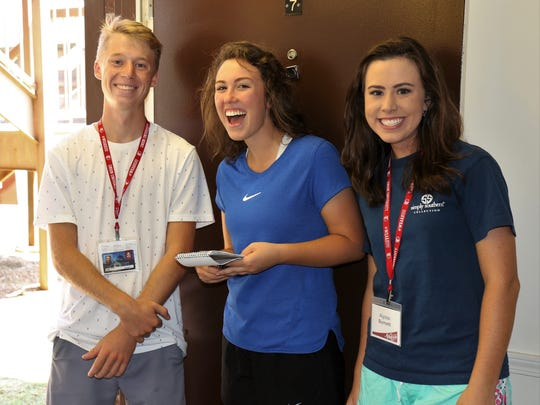 Freshman student Reagan Oliver meets new friends Delaney Sain and Alyssa Burnett during move-in day on Friday at Union University.