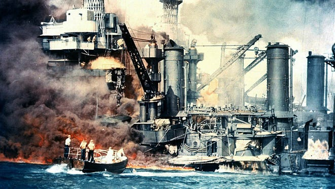 This Dec. 7, 1941, photo from The National Archives shows the USS West Virginia burning after the surprise Japanese attack on Pearl Harbor, Hawaii.