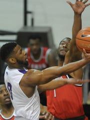 ACU's Jaylen Franklin soars to the basket as Lamar's