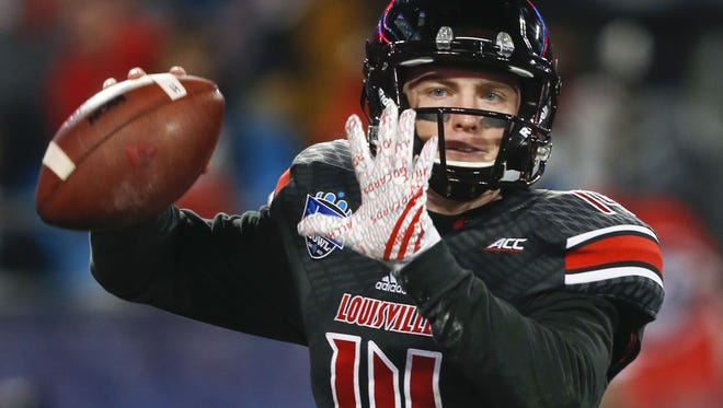 Louisville's Kyle Bolin drops back for a pass late in the fourth quarter at the 2014 Belk Bowl in Charlotte, North Carolina Tuesday evening. Georgia beat Louisville 38-14. Bolin had 300 yards from 20-for-40 attempts. He was sacked three times. Dec. 30, 2014 By Matt Stone/The Courier-JournalLouisville quarterback Kyle Bolin was 20-for-40 in passing with 300 yards but three interceptions in the Cards' 37-14 loss to Georgia in Belk Bowl. Dec. 30, 2014.