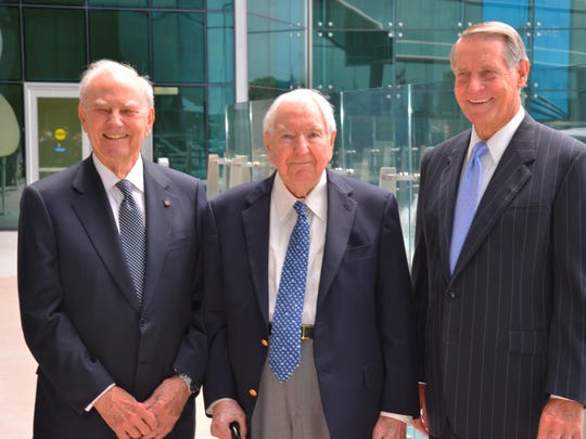 Retired Harris Corp. chief executive officers (left to right) Jack Hartley, Joe Boyd and Phil Farmer attended the February 2015 grand opening of the Harris Technology Center in Palm Bay.