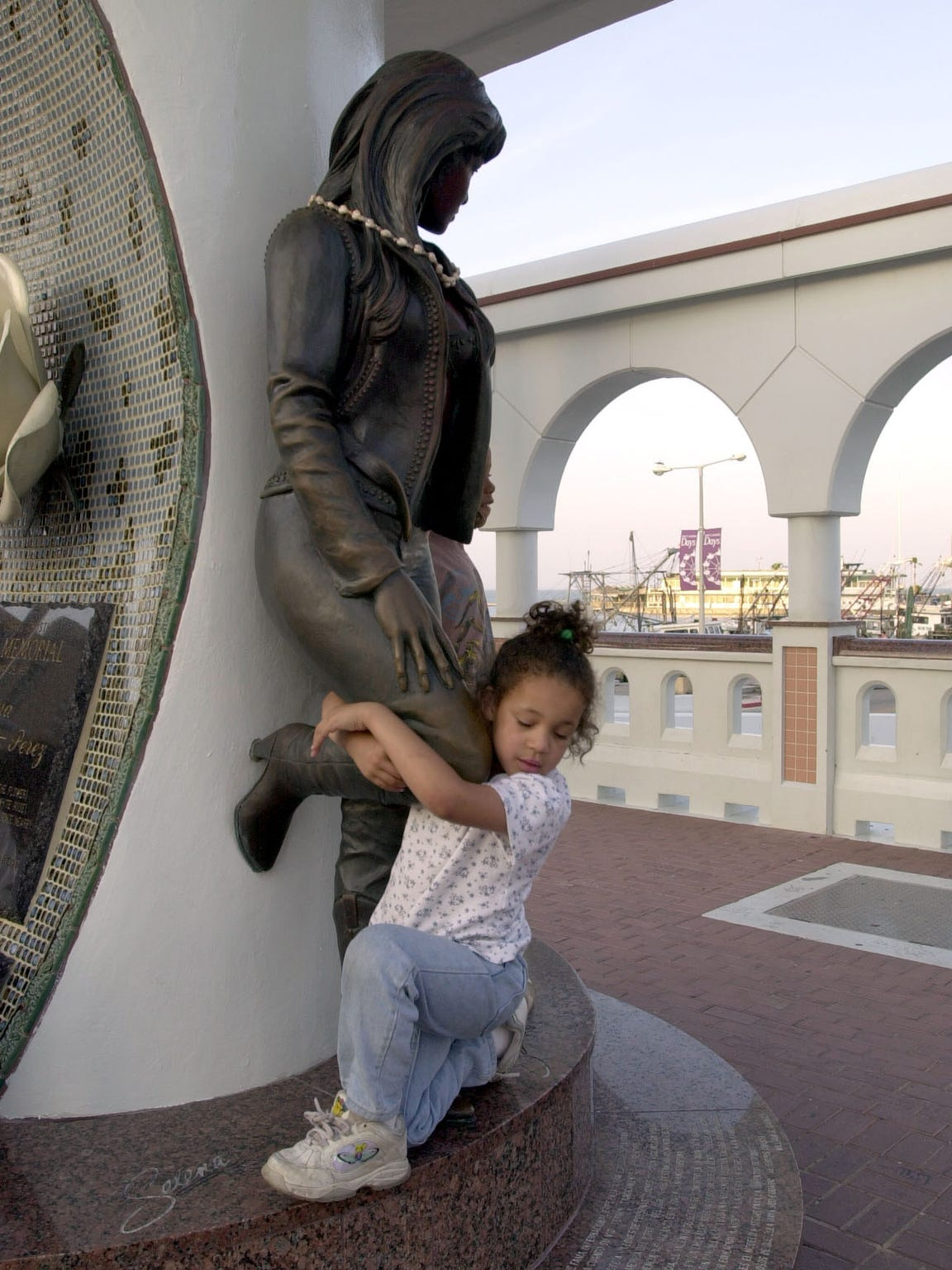 Selena Bates, 6, of Las Cruces, NM, hugs the leg of