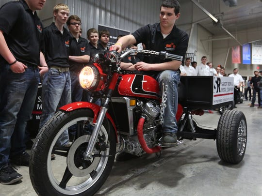 Mishicot's Project Mini-Chopper team captain Brandon Boettcher starts the engine of their chopper for the first time at the unveiling presentation at Manitowoc County Ice Center on Friday, April 22. This year is Project Mini-Chopper's eighth year of collaboration between high schools in Manitowoc County and sponsored area companies.