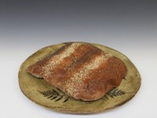 Lavash bread is displayed on a ceramic plate. Students