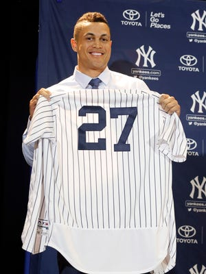 Dec 11, 2017; Orlando, FL, USA; New York Yankees outfielder Giancarlo Stanton (27) is introduced at a press conference at Walt Disney World Swan and Dolphin Resort. Mandatory Credit: Kim Klement-USA TODAY Sports ORG XMIT: USATSI-377188 ORIG FILE ID:  20171211_ajw_sv7_151.jpg