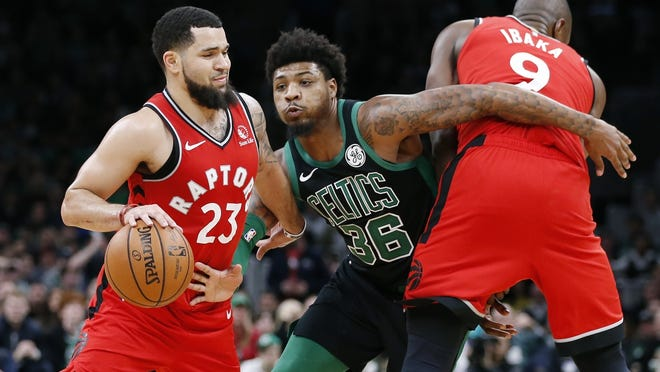 Toronto Raptors guard Fred VanVleet (23) drives past Boston's Marcus Smart as Serge Ibaka (9) provides a screen during a game in Boston, Saturday, Dec. 28, 2019.