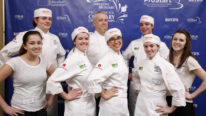 South Salem High School's culinary team won $9,500 in scholarships and the chance to compete nationally. From left to right front: Justine Grassman (alternate), Megan Lindsey, Jazmine Cervantes, Sierra Hurtado. Left to right rear: Draven Morehead, instructor Todd Wieweck, Mark Lunge, Karaline Richey (alternate)