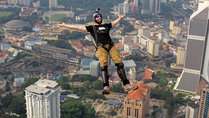 BASE jumper Luke Denniss of Australia gestures as he