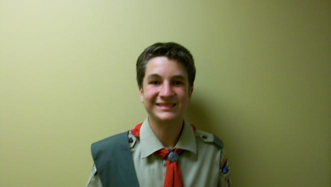 Nicholas Cohen of East Rochester, a member of Troop 136, sponsored by First Baptist Church, painted the First Baptist Church.