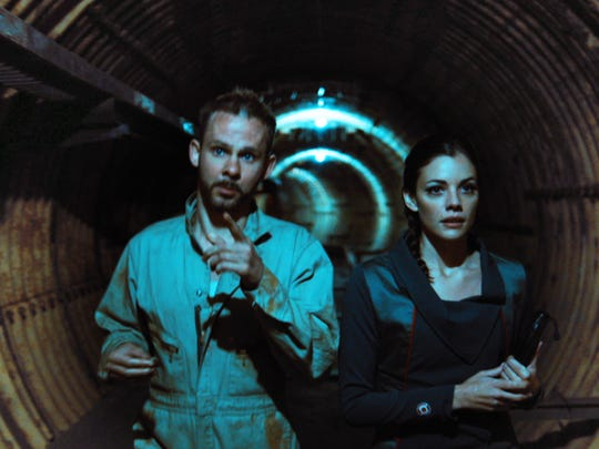 "Dominic Monaghan as Robinson and Sarah Habel as Abby in the sci-fi thriller film ""Atomica,"" a Syfy Films release."