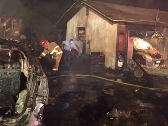 One resident was burned in a fire that destroyed two