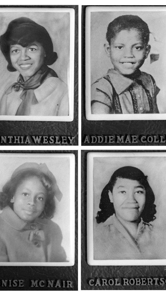BIRMINGHAM POST-HERALD Cynthia Wesley, Addie Mae Collins, Denise McNair and Carol Robertson, who were killed in the bombing of the Sixteenth Street Baptist Church in Birmingham, Ala., in 1963, are portrayed in portraits displayed at the church.  Photo/Birmingham Post-Herald)