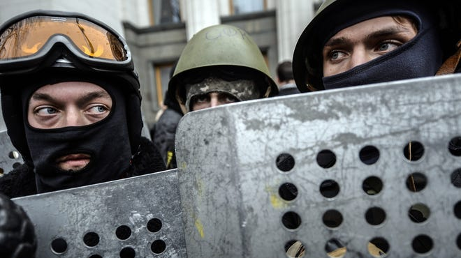 Anti-government protesters stand guard in front of the parliament building in Kiev on Feb. 22, 2014.