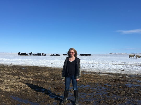 Warmer temperatures have exposed the mud underneath the snow on the Graham Ranch, but Abby Hutton is still all smiles.