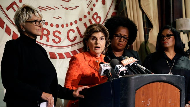 Attorney Gloria Allred, second from left, introduces Bill Cosby accusers Elizabeth, left, Charlotte Fox, second from right and Sarita Butterfield pm Thursday, Aug. 20, 2015, in New York.