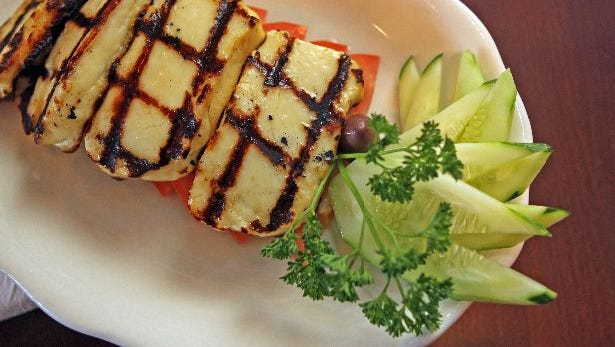 Holloumi, grilled goat cheese is a popular dish served at Elia Taverna in Bronxville May 24, 2011.
