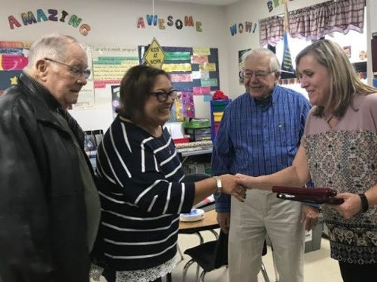 Koenig Elementary third-grade teacher Mary Basken was named 2018 Teacher of the Year. Presenting the award to Basken are members of the Two Rivers Neshotah Charitable Foundation: Bob Bergeon, Lisa Turner and Herman Gagnon.