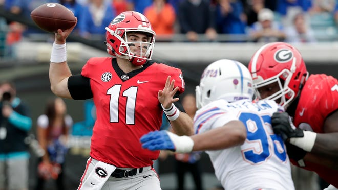 Georgia quarterback Jake Fromm (11) completed 17-of-24 for 240 yards, three TDs and no interceptions in the Bulldogs'  36-17 win over Florida on Saturday in Jacksonville.
