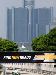 Jun 5, 2016; Detroit, MI, USA; A general view of the GM Renaissance Center as Team Penske driver Simon Pagenaud (22) of France approaches the finish line during the qualifying session for the Chevrolet Dual in Detroit Race 2 at The Raceway at Belle Isle Park. Mandatory Credit: Raj Mehta-USA TODAY Sports