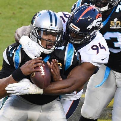 Carolina Panthers quarterback Cam Newton (1) is tackled