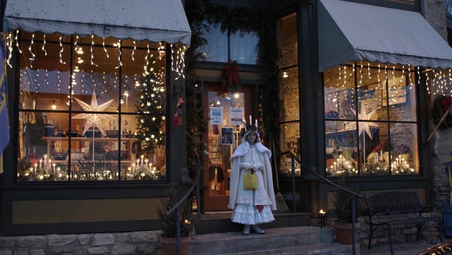 Santa Lucia walks the streets of Stockholm during the village's Christmas celebration.