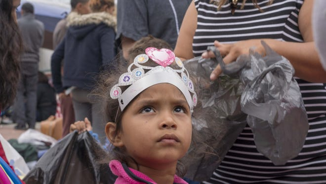 Central American migrant children camped outside the entrance of the San Ysidro port of entry on April 30, 2018. Locals and other humanitarian organization bring the blanket, clothing, and food after being turned away Sunday by U.S. Customs and Border Protection officials on April 30, 2018.