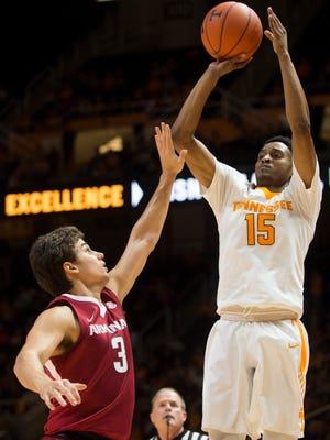 Tennessee's Detrick Mostella, right, attempts a shot past Arkansas' Dusty Hannah on Jan. 3 at Thompson-Boling Arena.