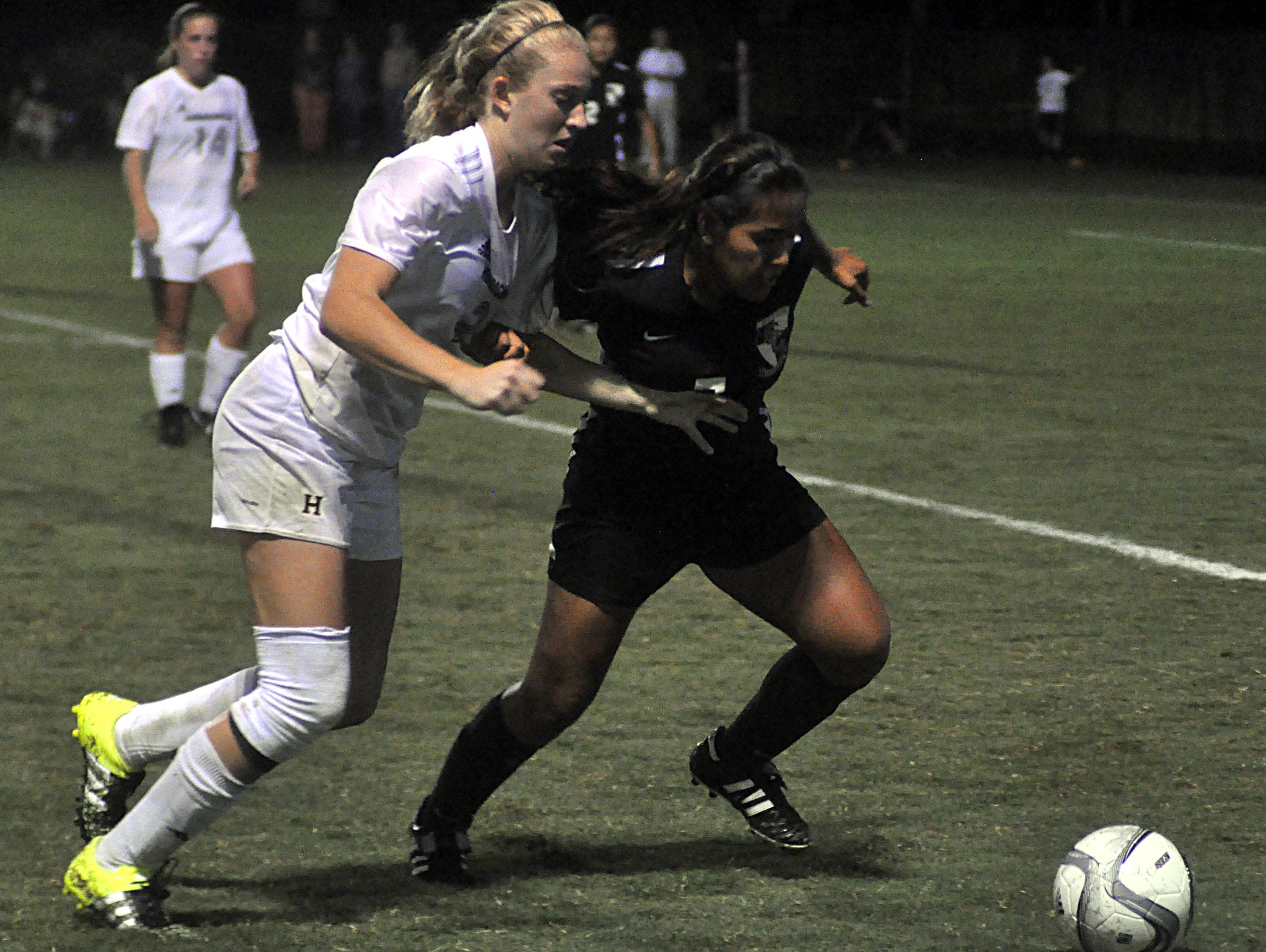 Hendersonville High sophomore Brooke Long (left) battles with Station Camp senior Heidy Orellana for a loose ball during the first overtime period on Tuesday evening.