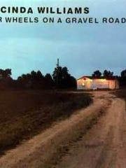 """Car Wheels on a Gravel Road"""