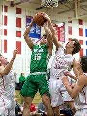 Brick's Cole Gruschel goes to the hoop as Wall's Andy