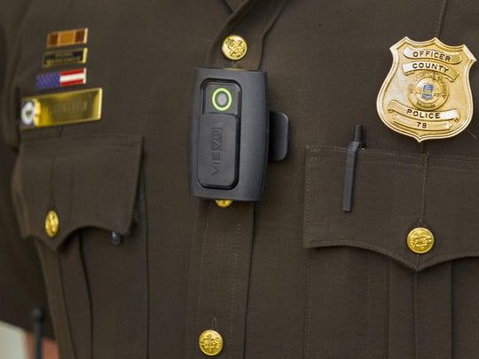 A New Castle County Police Department officer models a body camera