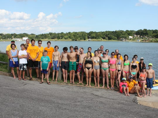 Participants in the Paddle for Packs fundraiser pose for a picture. The fundraiser organized by Pensacola High IB students contributed to feeding impoverished elementary students in Escambia County.